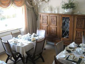 A restaurant or other place to eat at Dirreen House