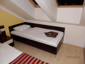 Postel nebo postele na pokoji v ubytování Free Apartman Besenova