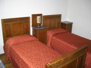 Letto o letti in una camera di L'Orto Delle Palme
