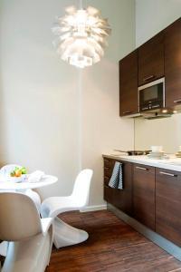 Cuisine ou kitchenette dans l'établissement Apartment Nyhuset