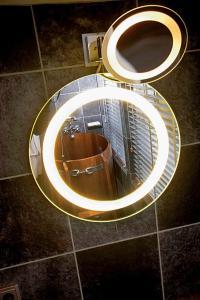 Ein Badezimmer in der Unterkunft Home Luxury Apartments