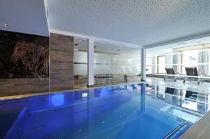 The swimming pool at or near Sunnsait - Appartements für Genießer