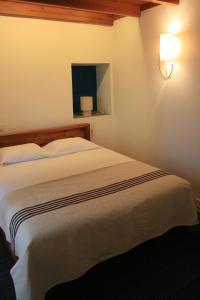 Uma cama ou camas num quarto em Casa de Almagreira