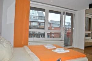 Ein Bett oder Betten in einem Zimmer der Unterkunft Business Apartment