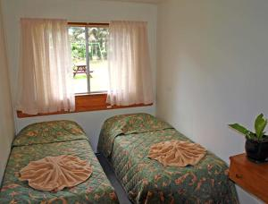 A bed or beds in a room at Pinevalley