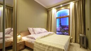 Кровать или кровати в номере OldRigaLuxApart