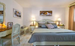 A bed or beds in a room at Agrimia Holiday Apartments