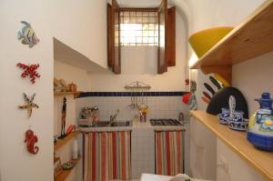 Dapur atau dapur kecil di Casa Bouganville