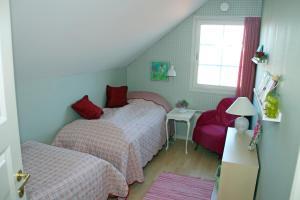 En eller flere senge i et værelse på Falster Bed & Breakfast