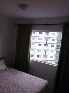 A bed or beds in a room at Apartamento Riviera Park