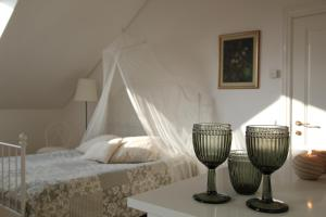 A bed or beds in a room at Villa Sofia Boutique Trakai