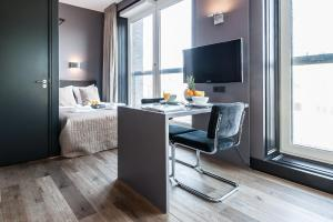A television and/or entertainment center at Citypark Apartment Suites