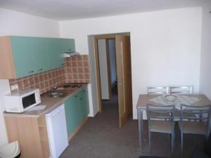 A kitchen or kitchenette at Swertia