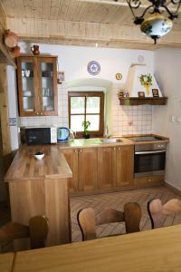 Kuchyň nebo kuchyňský kout v ubytování Chata Donovaly