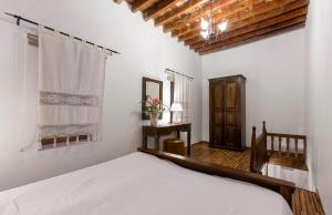 A bed or beds in a room at Lindos Boutique - Adults Only