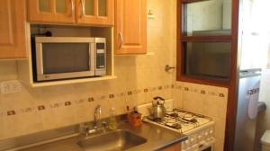 Una cocina o kitchenette en Departamento en Villa Gesell Norte