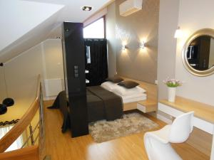 A bed or beds in a room at Apartamenty Platinum przy Focusie
