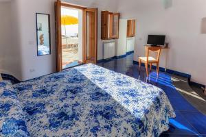 A bed or beds in a room at Villa Antica Macina