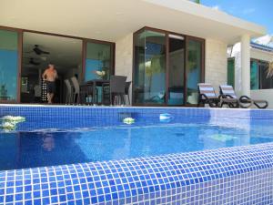 The swimming pool at or near Casa Moskito