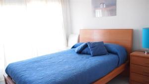 A bed or beds in a room at Apartamentos Elegance Denia