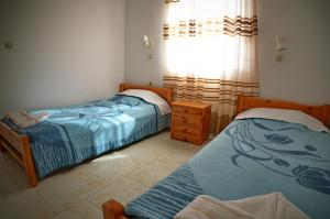 A bed or beds in a room at Studio Anthoula