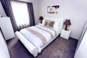 A bed or beds in a room at Casavino Luxury Villas