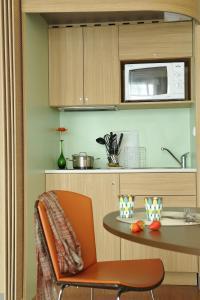 Кухня или мини-кухня в Aparthotel Adagio Nantes Centre