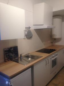 Kuchyň nebo kuchyňský kout v ubytování Recanto na Planicie