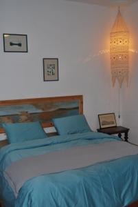 A bed or beds in a room at Spiti Anatoli