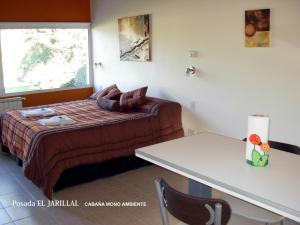 Una cama o camas en una habitación de Posada El Jarillal