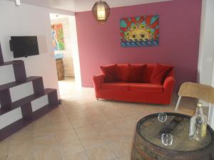 "A seating area at CoCoKreyol ""Saint Kitts"" & ""Nevis"""