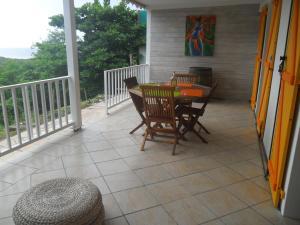 "A balcony or terrace at CoCoKreyol ""Saint Kitts"" & ""Nevis"""