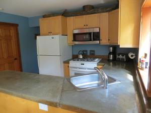 A kitchen or kitchenette at Tigh-Na-Clayoquot Vacation Rental