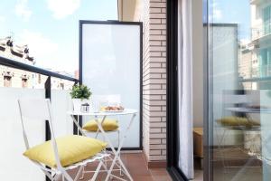 Ein Balkon oder eine Terrasse in der Unterkunft Feelathome Plaza Apartments