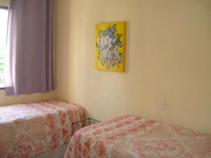A bed or beds in a room at Apartamento 3 Quartos Guarujá