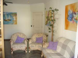 A seating area at Apartamento 3 Quartos Guarujá