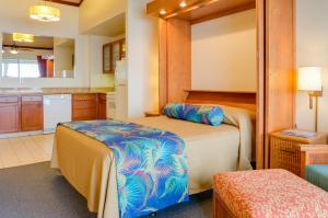 A bed or beds in a room at Napili Shores Maui by Outrigger