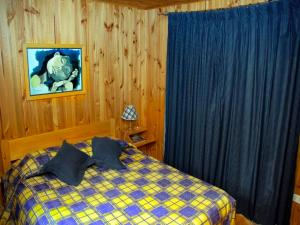 A bed or beds in a room at Cabañas Nordicas
