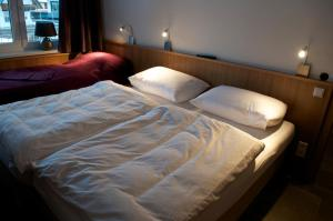 A bed or beds in a room at Schraberger - Top Holland