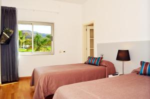 A bed or beds in a room at Villas Opal Anfi Tauro