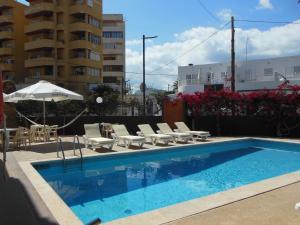 The swimming pool at or near Apartamentos Es Cantó