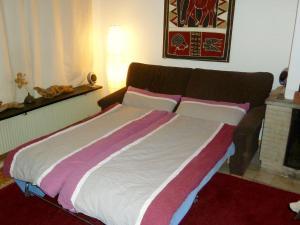 Ein Bett oder Betten in einem Zimmer der Unterkunft Ferienwohnung der Familie Scheel in Celle