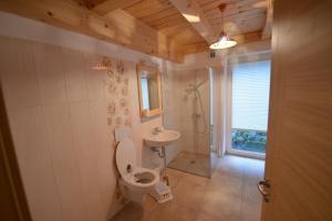 A bathroom at Apartments Mojca