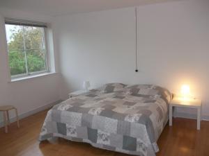 Ένα ή περισσότερα κρεβάτια σε δωμάτιο στο Børglum Mejeri Holiday Apartment
