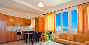 A kitchen or kitchenette at Cathrin Beach Apartments