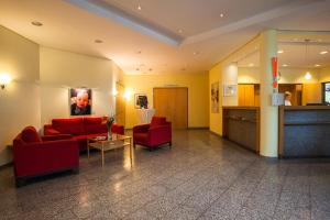 A seating area at Aparion Apartments Berlin Family