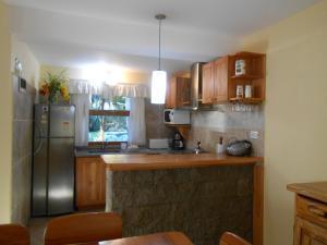Una cocina o kitchenette en Bungalows Maniu