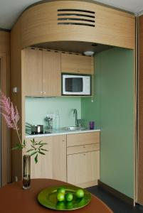 A kitchen or kitchenette at Aparthotel Adagio Bordeaux Centre Gambetta