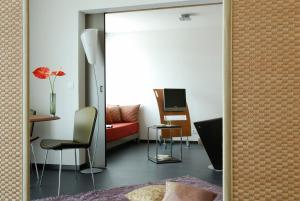 A television and/or entertainment center at Aparthotel Adagio Bordeaux Centre Gambetta