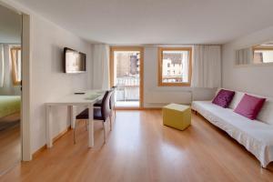 Zona de estar de Cabana Apartments
